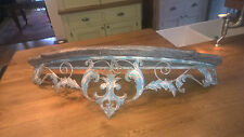 Vintage distressed style shelf with ornate metal support bracket