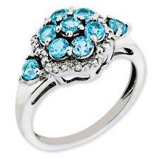 Sterling Silver Light Blue Topaz .05 CT Diamond Flower Ring 2.83 gr Size 5 to 10