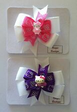HELLO KITTY DOUBLE PINWHEEL BOW HAIR CLIP - PINK OR PURPLE