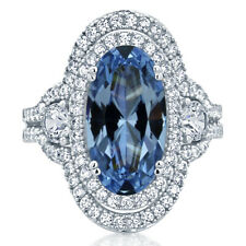 Women 32MM Sterling Silver Oval 5.75ct Simulated Blue Topaz Cocktail Ring Band
