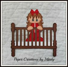 baby girl in crib premade paper piecing for scrapbook page album border die cut
