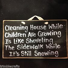 Cleaning house children growing like shoveling sidewalk while snowing sign wood