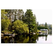Poster Print Wall Art entitled Placid river with docks, boats and boathouse,