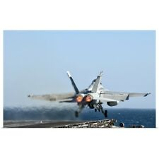 Poster Print Wall Art entitled An F/A-18F Super Hornet launches from the flight