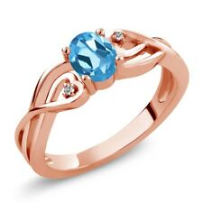 0.51 Ct Oval Swiss Blue Topaz White Diamond 18K Rose Gold Plated Silver Ring