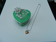 trinket box, green heart glass with amber coloured necklace