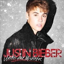 Under The Mistletoe [CD/DVD Combo] [Deluxe Edition] 2011 by Justin Bieber