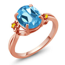 2.76 Ct Oval Swiss Blue Topaz Yellow Sapphire 18K Rose Gold Ring