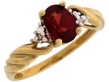 10k or 14k Yellow Gold Oval Cut Garnet and Diamond Twisted Band Ladies Ring