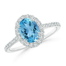 1.7 ctw Oval Swiss Blue Topaz Ring with Diamond Accents White Gold/ Platinum