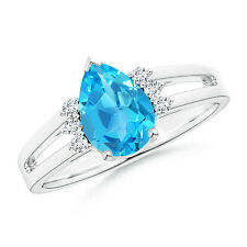 Solitaire Pear Blue Topaz Ring With Triple Diamond Accents in 14k White Gold