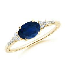Oval Sapphire Solitaire Ring with Trio Diamond Accents 14k Yellow Gold