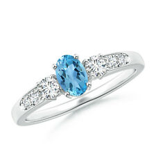 Three Stone Oval Natural Blue Topaz and Diamond Ring with Accent  14k White Gold