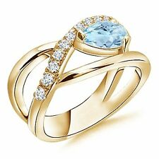 Criss Cross Pear Shaped Aquamarine Ring with Diamond Accents Gold/Platinum