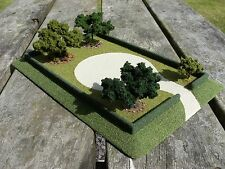 N gauge model railway layout garden scenery with trees hedges and flower beds