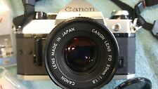 Canon AE-1 Program vintage camera with bag, lenses and filters