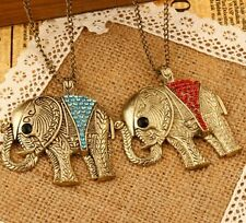 lovely elephant necklace with red and blue rhinestones