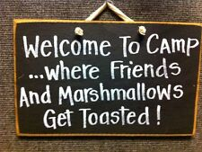Welcome camp where friends marshmallows toasted sign wood camper cabin firepit
