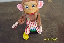 VINTAGE BATTERY OPERATED MONKEY THAT LITES LITES UP MISSING CYMBALS
