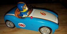 Special Agent Oso action figure in race car, with sounds