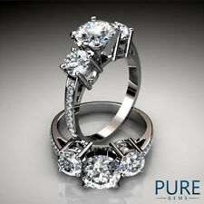 Three Stone Past Present Future Pave Set Engagement Ring in Gold and Platinum