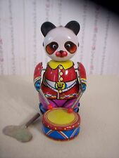 "VINTAGE ""PANDA DRUMMER & TRAINING PLANE"" TIN WIND-UP TOYS"