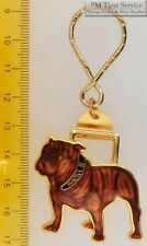 Sturdy key chain with a gold-toned & multi-colored enamel Mack bulldog shield