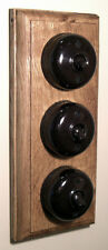 Three Bakelite Period Light Switches on an Oak Pattress