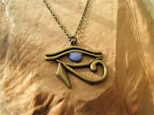 Egyptian Eye of Horus pendant necklace, violet eye  Wedjat, Ra.