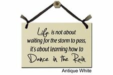 Life is not about waiting for the storm to pass...- Sign