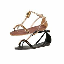 Flat sandals with gladiator style and gold edding and beaded detail