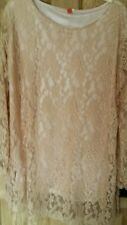 Cream /ivory lace long sleeved dress without tags. Never been worn.