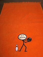 """11x18 fringed bowling Towel Embroidered with a  """"Stick Bowler"""" embroidered."""