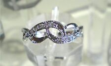 Intertwined ring - 18K white gold plated with Swarovski Crystal Various Sizes