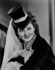 Olivia DeHavilland Portrait in Blouse with Magician Hat High Quality Photo