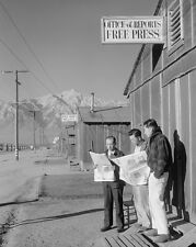 Japanese-American internees read newspapers at Manzanar Relocation Photo Print