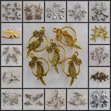 Na0124-Na5090 Wholesale Tibetan Silver/Antiqued bronze/Dark gold-tone Bird charm