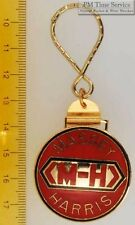 Sturdy key chain with a round gold-toned Massey Harris shield in red