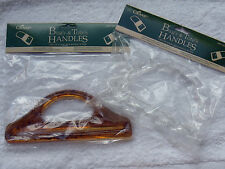 COVER PLASTIC BAG HANDLES.  AMBER AND CLEAR COLOURS.