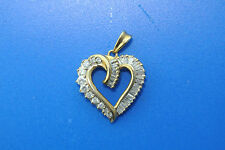 10k yellow gold heart shaped pendant with round and baguette diamonds 2.00TCW