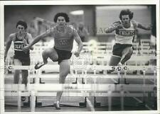 1977 Press Photo WV track and field athlete, Mike Houston, leaps over hurdle