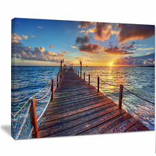 Design Art 'Beautiful Sunset Over Sea Pier' Photographic Print on Wrapped Canvas