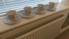 Set of 4 pretty gold rimmed china tea cups and saucers