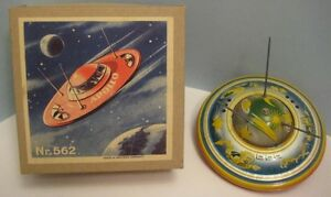 old tin friction toy apollo flying