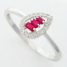 RUBY & DIAMOND RING. 3 BAGUETTE CUT RUBIES + 18 DIAMONDS IN SOLID 9K WHITE GOLD.