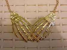 skeleton hand pendant,choker, bib statement necklace,gold tone ,nwot .unusual.