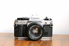 CANON AE-1 Program 35mm SLR Camera  w/ Canon 50mm f/1.8  * Works, Has fault/READ