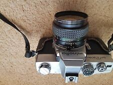 Minolta 303b SLR Camera with extra zoom lens flash, and carry case