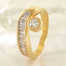 Ring in 750/- Gelbgold mit 16 Diamanten Brillant, Trapez + Baguette-Schliff