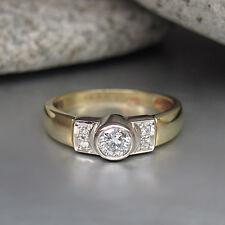 Ring mit ca. 0,26ct W-si Brillant in 585/14K Weiß-/Gelbgold